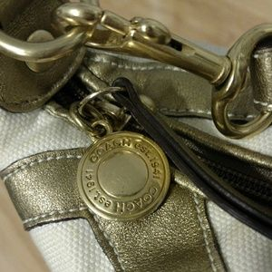 Coach Bags - Coach gold and white small purse